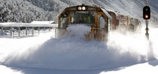 Incredible Footage of a Speeding Train Plowing Through Heavy Snow on the Tracks Like its Nothing