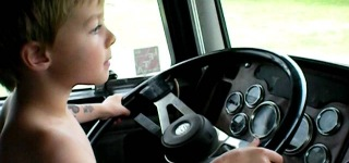 Little Boy Driving a BIG RIG