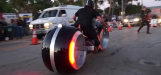 The Sheriff's Tron Bike Is In Town With Hot Girls On It