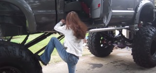 Cute Girl Giving a Struggle to Climb into Giant Ford F-250