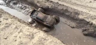 Super-Cool Battle: Traxxas X-Maxx Vs. Mud