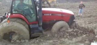 Tractor Gets Stuck In the Mud and Rescues Itself Splendidly