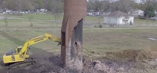 Horrific Close Call: Smokestack Demolition Goes Terribly Wrong and the Operator Narrowly Escapes the Death