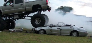 This Is What We Call Crazy: Monster Truck Does Burnouts on Two Cars