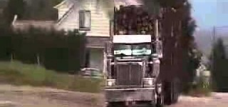 How Not to Drive a Huge Logging Truck with Pitch Black Smoke Coming Out Of Its Pipes!