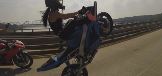 INSANE Stunt - Beautiful GIRL Riding Wheelies On A Long Highway