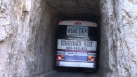 Bus Drives Through Extremely Narrow Tunnel in Needles Highway of South Dakota