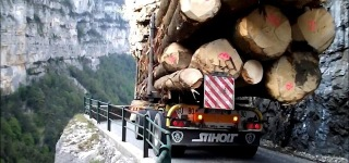 Driving an Overloaded Logging Truck Through an Incredibly Narrow Road