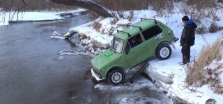 Crazy Russian Driver Gets a Lada Niva Into Water but Has Trouble Getting It Out!